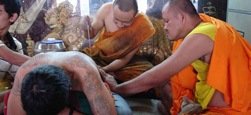 Magica Sak Yant Tattoo in Thai temple blessed by the monk