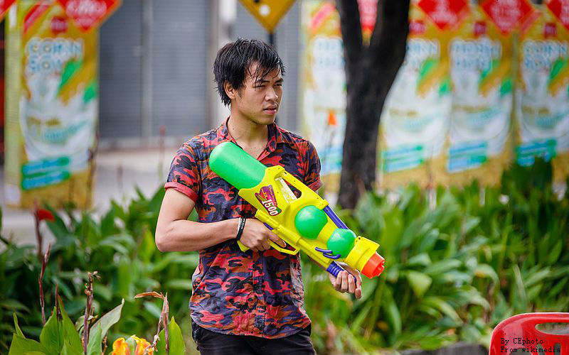 Thai people who equipped with a large water gun,