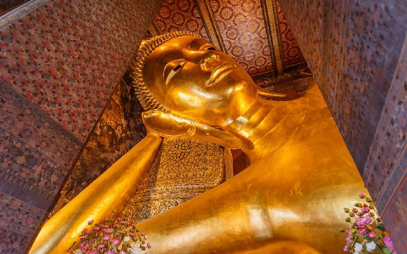 Picture: Reclining Buddha gold statue face. Wat Pho, Bangkok, Thailand